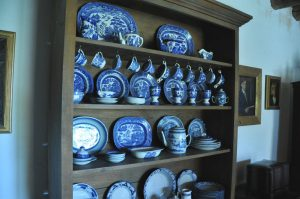 Walnut hutch with Blue Willow China.