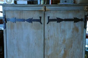 Custom homemade decorative door hinges in the Couse home.